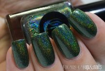 Josephine / A blackened green with a rainbow holographic finish