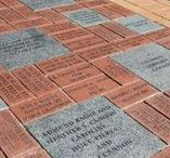 Alumni Walk / Alumni & friends of the Auburn Alumni Association have purchased bricks and stone pavers along the campus' new Alumni Walk in support of student scholarships. The Alumni Walk is a way to leave a permanent legacy on Auburn University's campus. The bricks can be inscribed with a name, graduation year, and a personalized message and are placed in the pathway outside of the Auburn Alumni Association building.