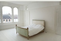 bedroom. / simple. white. wrought iron bed. wood. plants.  / by Vivian