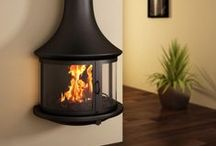 Wall Mounted Stoves / Fixed to the wall, these stoves offer a captivating perspective of the fire and a unique element to every home.