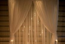 Wedding Tulle Ideas / Tulle is a popular and inexpensive wedding supply. From reception decorations and favors, to wedding veils, to guest and couple's chairs, here are some ideas on what to do with tulle in your wedding.