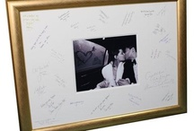 Wedding Signing Frames / A guest signing frame (or signature frame) is a lovely alternative to the traditional wedding guest book. The wedding photo signing frame is displayed at the reception for your guests to sign.   After your wedding, just add your favourite wedding photograph behind the mount, and you will have a lovely keepsake of your wedding day.  The signing frame can be hung in a portrait or landscape format and comes with a double aperture ivory colour mount and backboard. The mount is cut to fit a photo