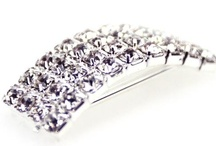 Buckles and Ribbon Slides / These beautiful Diamante Buckles / Ribbon Slides are made with Grade A Rhinestones and have a silver metal base - they really sparkle and are perfect for making your own wedding invitations, wedding favour boxes and for many other wedding crafts.  Available with both vertical and horizontal inner bars the diamante buckles or ribbon slides can be used to create wedding invitation and stationery designs with both vertical and horizontal ribbons.