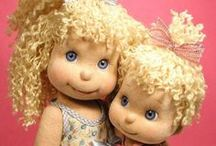 Dolls: Rag, Stuffed, and Fluffed / These dolls are collectables that are stuffed dolls.  They can be rag dolls, trademark dolls, are handmade.  But only stuffed dolls here.