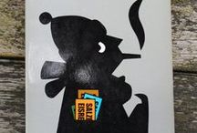 Dick Bruna's Zwarte Beertjes bookcovers / Dick Bruna (1927 in Utrecht) is a Dutch author, artist, illustrator and graphic designer.  His best known creation is Miffy (Nijntje in the original Dutch),    Bruna also illustrated and designed book covers, posters and promotional materials for his father's publishing company  A.W. Bruna and Zoon.  His most popular designs graced the covers of the Zwarte Beertjes series of books.