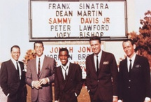 "The Rat Pack / The Rat Pack was a group of actors originally centered on Humphrey Bogart. In the mid-1960s it was the name used by the press and the general public to refer to a later variation of the group, after Bogart's death, that called itself ""the summit"" or ""the clan,"" featuring Frank Sinatra, Dean Martin, Sammy Davis, Jr., Peter Lawford, and finally, Joey Bishop, who appeared together on stage and in films in the early-1960s, including the movie Ocean's 11."