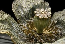 René Jules Lalique ~ Glass Artist / René Jules Lalique (April 6, 1860 -  May 5,  1945, Paris) was a French glass designer known for his creations of perfume bottles, vases, jewelery, chandeliers, clocks and automobile hood ornaments.  He started a glassware firm, named after himself, which still remains successful.