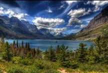 """Glacier National Park / Glacier National Park is part of the Waterton-Glacier International Peace Park. It's also called the """"Backbone of the World"""" by the Blackfeet Tribe. Open year-round, it offers a variety of activities including biking, boat tours, trail rides and red bus tours."""