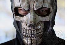 Masks/Helmets/Headdresses / A collection of masks, helmets, and headdresses.