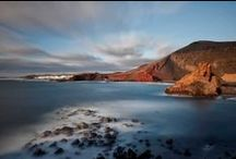 Lanzarote & La Graciosa / It is the colour of Lanzarote that lingers in the memory long after other images have faded. Forged from volcanic fire and warmed by an African wind, the stark landscape has a fragile beauty, its reddened shales fading into yellow, while delicate pale green lichens coat the volcanic slopes and pristine white-shell beaches fringe the Atlantic shore. / by Inntravel