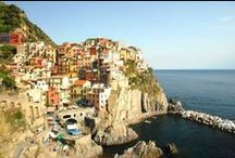 Along the Ligurian Coast / With warm, wooded mountains tumbling steeply down to little bays and sandy coves where fishing ports and small resorts of pastel-coloured houses nestle by the water's edge, the Ligurian Riviera, which stretches from the border with France down to Tuscany, is one of the natural wonders of Italy. Here, you can savour delicious fish and seafood, pesto and unusual white wines such as Sciacchetrà. http://goo.gl/7GzkHX