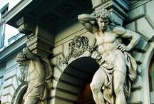 Telamones.Caryatids.Atlantes.Herms / Mythical figures serving as architectural adornments.