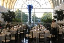 Monsanto Hall at the Garden / Monsanto Hall is the largest venue available for wedding receptions, rehearsal dinners and corporate events at the Missouri Botanical Garden.  This beautiful venue located in the Ridgway Center is adjacent to Spoehrer Plaza and boasts an impressive Chihuly chandelier acquired during the exhibit at the  Garden.