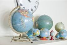 """Trending - Globe Displays / I've noticed that stylists (and regular people) are really focused on themed collections lately, especially globes! Sometimes they are paired with an oversized map, or in a """"space"""" themed kids room, but they always make the room loo well-travelled. / by Heather Lisi"""