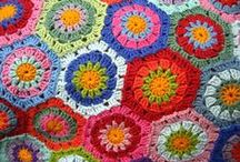 Granny Squares Galore / I love granny squares. The first one I made I could not stop and ended up with a one square afghan. I just kept going around.  / by Barbara Schodowski