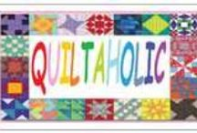 """My Quilt Magnets / These cute novelty """"quilty saying"""" magnets are a hit with quilters in any quilt shop.  18 different sayings are neatly displayed on a custom acrylic spinner rack.  Your cost is .50 per magnet and the suggested retail is $1.00. Plus for a limited time, Free domestic shipping on the setup order.  Initial orders orders come with 25 of each design and can be reordered as needed."""