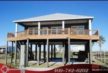 """1222 Galveston Avenue / Front Row, Fully Furnished Beach House, Nestled in a Cove with Stunning 180 Degree View of the Gulf of Mexico, Bird Sanctuary, North Jetty, and Fort Travis Seashore Park. The kitchen features granite countertops and the home has vinyl wood floors and neutral paint throughout. This home has been featured on Discovery Channel's """"Buying Beaches"""" and HGTV's """"Beach Front Bargain Hunter."""""""