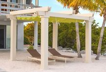 Brown Jordan Structures / Pergolas, canopies and trellis structures are fundamental outdoor elements producing architectural interest and cooling shade for your outdoor living environment.  Manufactured using commercial grade aluminum or structural fiberglass these unique shade structures are created to enhance your outdoor setting for a lifetime.