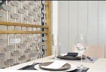 Casa Santoña / diseño, creaciony reforma ,de restaurante y cafetería ,situado en la calle Nazaret en  Madrid,diseño de la nueva imagen de este espacio ,estanterias hexagonale ,cava de vino ,biombo hecho con latas de conservas ,etc