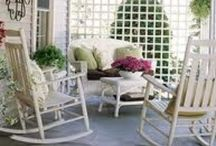 porch perfection.  / welcome home porch. a place to read the paper. a place to enjoy the view.