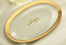 Judaica / The Annieglass Judaica Collection of clear textured glass serving platters hand-painted in 24k gold or genuine platinum bring sophisticated elegance to Jewish holiday tables. Mix with pieces from the Annieglass Roman Antique Collection and tastefully accentuate everything from sleek, modern tableware designs to delicate, heirloom porcelain. Judaica pieces are designed as heirlooms and make the perfect gifts for weddings, anniversaries and other special occasions.