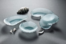 Shell /  Inspired by seashells strewn about the beach near the Annieglass studio on Monterey Bay, the handcrafted Annieglass Shells Collection features frosted glass dinnerware and an array of seashell designs in both ultramarine and frosted glass--two of which are in the permanent collection of the Smithsonian American Art Museum. The variety of shapes in this dishwasher safe collection brings life to any home décor, no matter your shoreline.