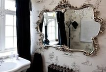 Mirror Mirror / I may have a slight obsession with mirrors. 20 vintage beveled edge frameless mirrors on one wall isn't that many - is it? There also seems to be a collection of rococo style mirrors growing in the bathroom.