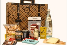 "Gourmet Gift ""Suitcases"" / Travel-inspired, exquisite gourmet gift assortments of fine foods from Spain. These deluxe collections are packaged in eco-friendly, custom-designed suitcase boxes and come with letterpressed ""passports"" describing each food."