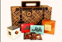 "Gourmet Gift ""Carry-Ons"" / Travel-inspired, exquisite gourmet gift assortments of fine foods from Spain. These collections are packaged in eco-friendly, custom-designed suitcase boxes and come with letterpressed ""passports"" describing each food."