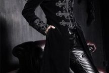 Dark Cabaret Style / Gothic, steampunk, lolita, burner, circus, military, and Victorian fashion elements compose this alternative fashion niche. Never too serious, always feminine, regal, and decadently dark.