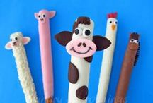 Pretzel Pops / Decorated pretzel rods. Pretzels decorated for holidays and special occasions. Chocolate Dipped pretzels decorated with modeling chocolate, fondant, and candy.