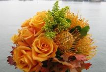 Fall Flowers  / Festive fall flowers in bright yellows and oranges accented with deep reds can get even the most dedicated summer lovers in the mood for cider and pumpkin pie!