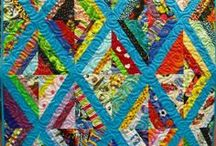 My Quilts / Some of my completed quilts and fabric projects! / by L & R Designs Quilting