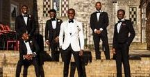 Mens Wedding Suits and Outfits / We know you've probably been planning your wedding dress for a long time, but have you thought about your groom's outfit yet? If your husband-to-be isn't a style aficionado, he may need your help deciding on a men's wedding suit for the big day. More than just a blazer and trousers, you've got to consider the style, fabric, colour as well as a shirt, tie, shoes and buttonhole. Not to mention what the groomsmen will wear to compliment him.