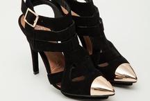every girl loves shoes / by Amanda Kamla