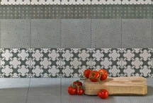 Encaustic x Majolica / Square ceramic tiles with intricate designs, patchwork patterns with a timeworn appearance, reminiscent of encaustic cement tiles or majolica, but made with high-tech printing techniques, putting a contemporary spin on a handcrafted process.