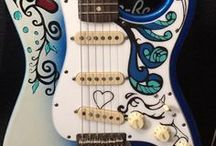 "Axetreme Custom Guitars / AxetremeCreations strives to provide innovative designs found no where else in the market, from color guitar neck plates and custom aged bodies and necks, to graphical and engraved pickguards. This board is dedicated to all the ""Axetreme"" guitars we have helped make possible!"