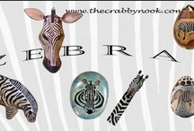 Zebras at The Crabby Nook / Everyone loves to use safari animals as decorating accessories!  They blend with every style. / by The Crabby Nook