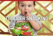 Snack Time / With NUK® and Gerber® Graduates® wide range of tableware and snacking products, your little one will tackle independent eating like a champ!