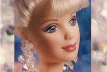 barbie collectibies / I always liked the holiday Barbie a lot but I could never see spending the money for something that was just going to gather dust. so now I can have them / by Shannon Evans