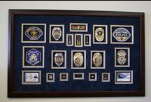 "Police and Firefighter badge frames. / Frame-It is Salt Lake City's Police, Firefighter and Military Badge framing specialists.  Every piece is custom designed and framed. ""Utah's finest Career showcase presentations."""
