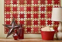 Quilts / Three layers of fabric, batting and a backing sewn together and quilted to use on beds for warmth or for decor