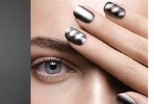 Magnetic Nails / Magnetic nail polishes contain iron powder that help form dark, wavy shapes created by a magnet.