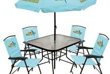 Margaritaville / The Margaritaville lifestyle is all about bringing the island atmosphere to any location. Sand and surf is completely optional.  Lightweight folding chairs make it easy to take the party with you to any concert or outdoor event. Or outfit your patio or pool area with our stylish, hardwood Margaritaville Adirondack chairs and matching tables.