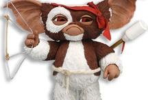 Gremlins - Mogwai Series 2 / Series 2 has Combat Gizmo, with his bow and arrow, Daffy, and Mohawk. All 3 figures have a small ball in the backs of their heads that let you move their eyes to change their expressions!