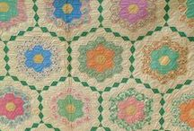 Flower Garden Quilt Inspiration / I'm *slowly* working on a Grandmother's Flower Garden quilt in 30s reproduction fabric. All paper pieced, hand-stitched. This will probably take me at least 20 years. These beauties are my inspiration.