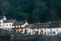 The Rising Sun / A 14th Century thatched smugglers inn overlooking a tiny picturesque harbour and Lynmouth Bay! Now the inn and the adjoining cottages, which once were homes for fishermen, comprise the Rising Sun Hotel. http://www.risingsunlynmouth.co.uk/