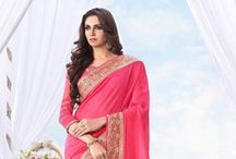 Designer Net Sarees / For a saree lover, it's a collection that can bring on the smiles! Our designer net sarees are hand-picked items that can make you look like one in a million. Yearning for a pink net saree with floral applique? Want to lay your hands upon a stunning black number embellished with motifs of mirror work, sequins, cutdana and beads? Get it all here – the blues and greens, the purples and pinks, the whites and creams. You deserve no less than our designer net sarees collection! / by Utsav Fashion