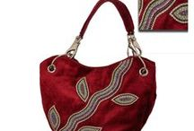 Handbags / Every occasion calls for a different bag, every traditional outfit asks for a special handbag to complement it. Confused about the right handbag for your ethnic occasion? A wonderful array of exotic handbags awaits you, and it's time you took a look. There are embedded potli bags, as well as gold and silver handbags like clutches and tote bags to match the occasion and the mood. Our bags are crafted out of raw silk, velvet, satin and cotton…how about discovering these masterpieces right away?