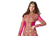 Best Selling Salwar Kameez / Get it all right here! Chartbusting Salwar Kameez that are hot favorites worldwide can be yours too. Take your pick from an array of Churidar Kameez and Abaya style Churidar Kameez in hot pink, pristine white, subtle beige, bold black and perky yellow. The stunning range is available in faux georgette or faux crepe, in net or raw silk or elegant cotton. So wear a bestselling Salwar Kameez and go take the celebrations by storm!